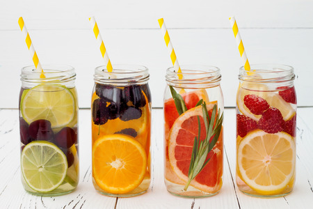 cold beverages: Detox fruit infused flavored water. Refreshing summer homemade cocktail Stock Photo