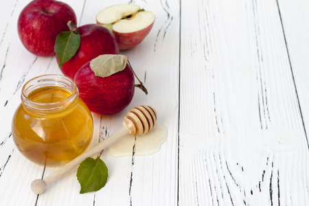 honey jar: Apple and honey, traditional food of jewish New Year - Rosh Hashana. Copyspace background