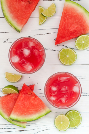 summer food: Watermelon margaritas - mexican style summer watermelon alcohol cocktail with lime. Cinco de Mayo drink recipe.Top view