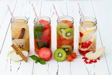 fruit in water: Detox fruit infused flavored water. Refreshing summer homemade cocktail. Clean eating Stock Photo