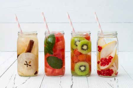 Detox fruit infused flavored water. Refreshing summer homemade cocktail. Clean eating 스톡 콘텐츠