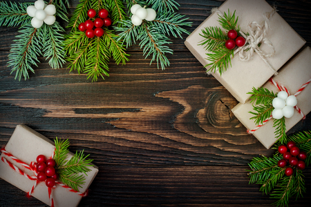 country christmas: Christmas presents in boxes on a wooden background with copy space. Toned