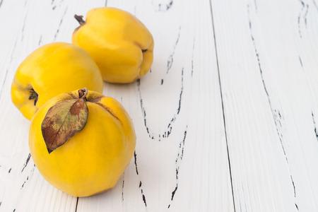 quinces: Ripe quinces on vintage wooden table. Copy space Stock Photo
