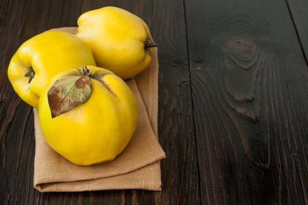 pectin: Ripe quinces on vintage wooden table. Copy space Stock Photo