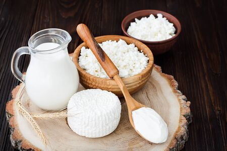 draining: Soft homemade fresh ricotta cottage cheese made from milk, draining on muslin cloth. Tzfat cheese with wheat grains. Symbols of judaic holiday Shavuot.