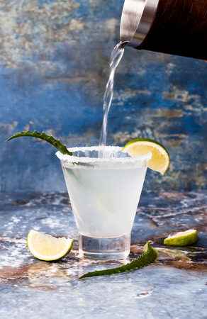 daiquiri alcohol: Aloe vera margarita cocktail with salty rim on marble table Stock Photo
