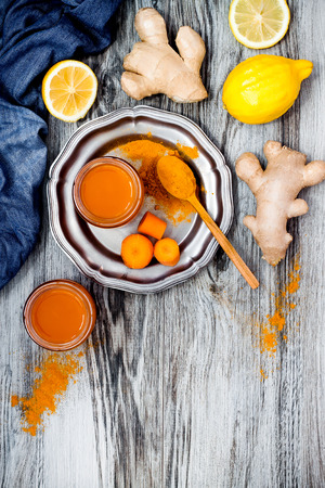 cleanse: Carrot ginger immune boosting, anti inflammatory smoothie with turmeric and honey. Detox morning juice drink, clean eating Stock Photo