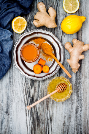 inflammatory: Carrot ginger immune boosting, anti inflammatory smoothie with turmeric and honey. Detox morning juice drink, clean eating Stock Photo