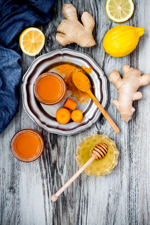 boosting: Carrot ginger immune boosting, anti inflammatory smoothie with turmeric and honey. Detox morning juice drink, clean eating Stock Photo