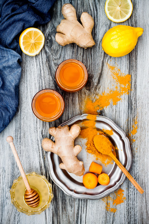 anti season: Carrot ginger immune boosting, anti inflammatory smoothie with turmeric and honey. Detox morning juice drink, clean eating Stock Photo
