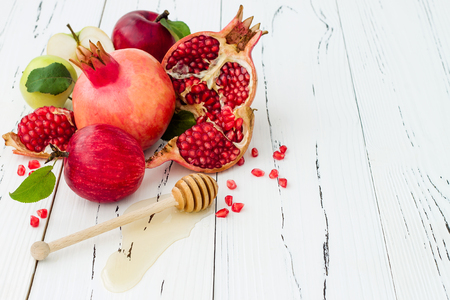 Apple and honey, traditional food of jewish New Year - Rosh Hashana. Copy space background