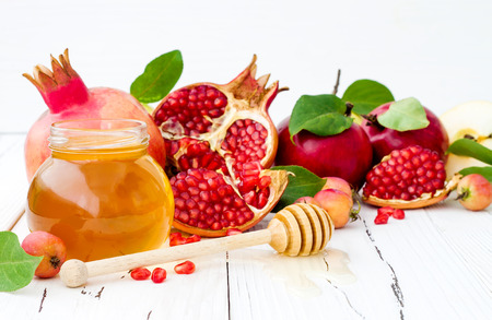 hashana: Apple and honey, traditional food of jewish New Year - Rosh Hashana. Copy space background