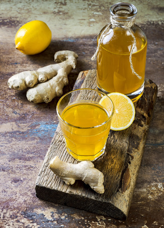 Homemade fermented raw ginger lemon kombucha tea. Healthy natural probiotic flavored drink. Stock Photo