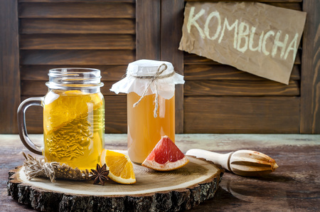 Homemade fermented raw kombucha tea with different flavorings. Healthy natural probiotic flavored drink. Copy space Banco de Imagens - 72631868