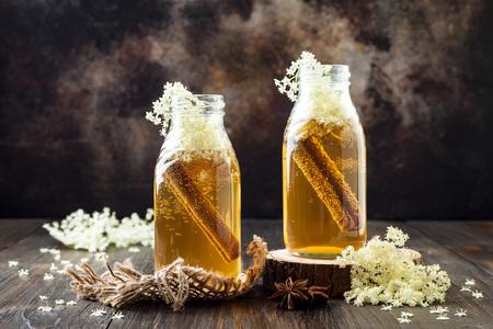Homemade fermented cinnamon and ginger kombucha tea infused with elderflower. Healthy natural probiotic flavored drink Stock Photo
