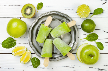 Detox, healthy green smoothie icecream. White wooden rustic background, overhead, top view, flat lay