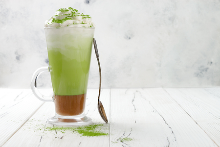 Matcha latte with salted caramel in tall glass Banco de Imagens