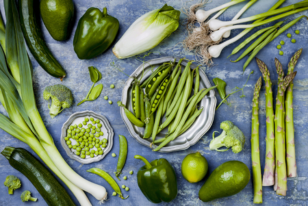 Green veggies group. Vegetarian dinner ingredients. Green vegetables variety. Overhead, flat lay, top view 스톡 콘텐츠