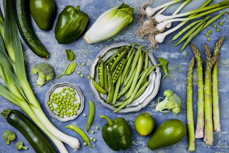 Green veggies group. Vegetarian dinner ingredients. Green vegetables variety. Overhead, flat lay, top view Foto de archivo