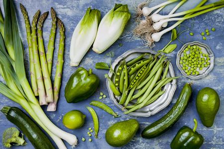 Green veggies group. Vegetarian dinner ingredients. Green vegetables variety. Overhead, flat lay, top view Stock Photo