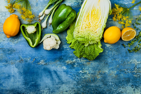 Green and yellow veggies group. Vegetarian dinner ingredients. Green vegetables variety. Overhead, flat lay, top view, copy space