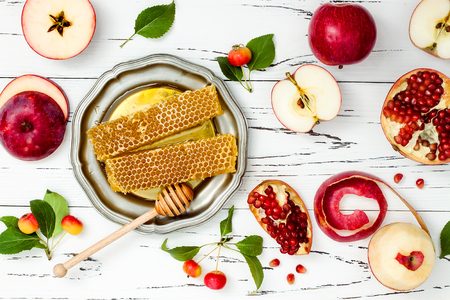 jewish: Apple, pomegranate and honey, traditional food of jewish New Year - Rosh Hashana. Stock Photo