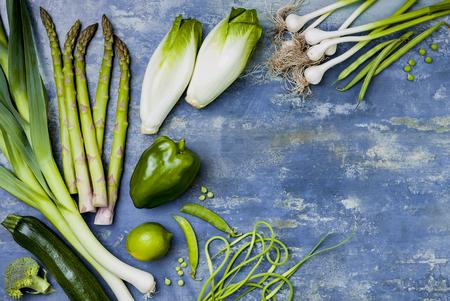 Green veggies group. Vegetarian dinner ingredients. Green vegetables variety. Overhead, flat lay, top view, copy space Stock Photo