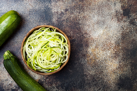 Zucchini spaghetti or noodles (zoodles) bowl. Top view, copy space
