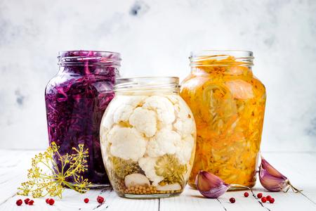 Sauerkraut variety preserving jars. Homemade red cabbage beetroot kraut, turmeric yellow kraut, marinated cauliflower pickles. Fermented food.