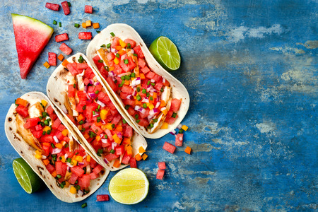 Mexican grilled chicken tacos with watermelon salsa. Copy space