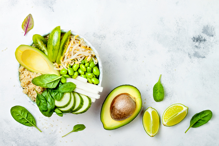 Vegan, detox green Buddha bowl recipe with quinoa, avocado, cucumber, spinach, tomatoes, mung bean sprouts, edamame beans, daikon radish. Top view, flat lay, copy space Stok Fotoğraf - 88581563