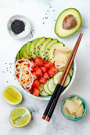 bean sprouts: Hawaiian watermelon poke bowl with avocado, cucumber, mung bean sprouts and pickled ginger. Top view, overhead, flat lay