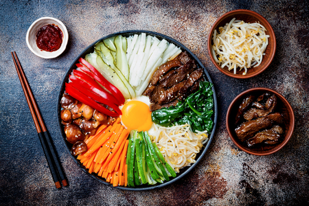 Bibimbap, traditional Korean dish, rice with vegetables and beef. Top view, overhead, flat lay 版權商用圖片 - 88581839