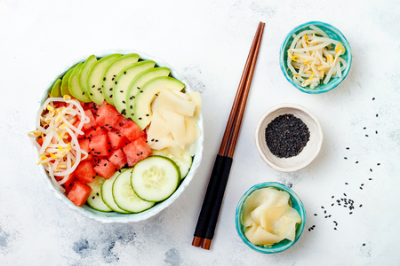 Hawaiian watermelon poke bowl with avocado, cucumber, mung bean sprouts and pickled ginger. Top view, overhead, flat lay, copy space 版權商用圖片