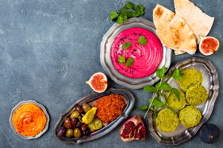 Middle Eastern traditional dinner. Authentic arab cuisine. Meze party food. Top view, flat lay, overhead, copy space Stock Photo