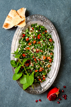 Middle Eastern traditional salad Tabbouleh. Authentic arab cuisine. Top view, flat lay, overhead