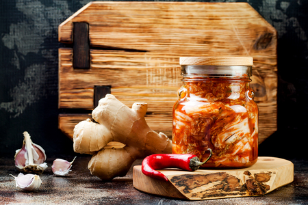 Cabbage kimchi glass jar. Korean traditional cuisine. Fermented food.