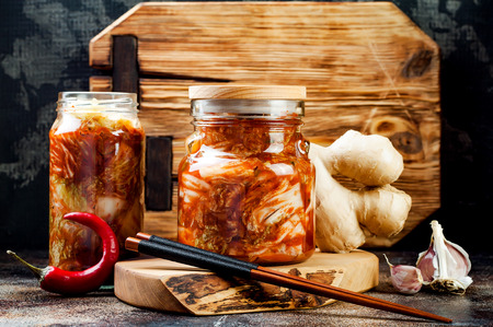 Cabbage kimchi glass jar. Korean traditional cuisine. Fermented food. Zdjęcie Seryjne - 91611768