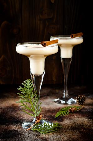 Christmas cocktail eggnog with grated nutmeg and cinnamon.