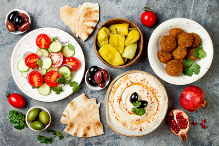 Middle Eastern traditional dinner. Authentic arab cuisine. Meze party food. Top view, flat lay, overhead Stock Photo - 94417139