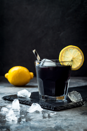 Detox activated charcoal black lemonade. Copy space.