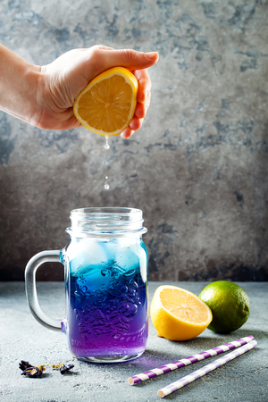 Butterfly pea flower blue iced tea or lemonade. Healthy detox herbal drink