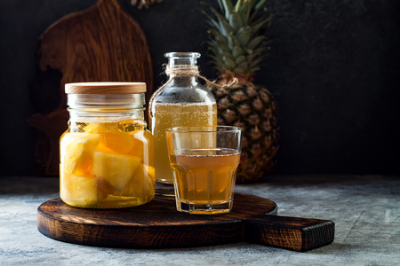 Fermented mexican pineapple Tepache. Homemade raw kombucha tea with pineapple. Healthy natural probiotic flavored drink. Copy space 스톡 콘텐츠