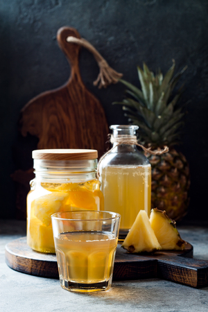 Fermented mexican pineapple Tepache. Homemade raw kombucha tea with pineapple. Healthy natural probiotic flavored drink. Copy space Stock Photo