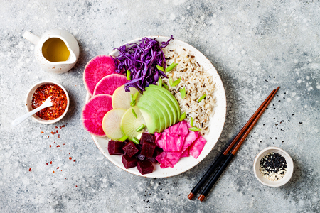 Vegan poke bowl with avocado, beet, pickled cabbage, radishes. Top view, overhead, flat lay Zdjęcie Seryjne - 103614855
