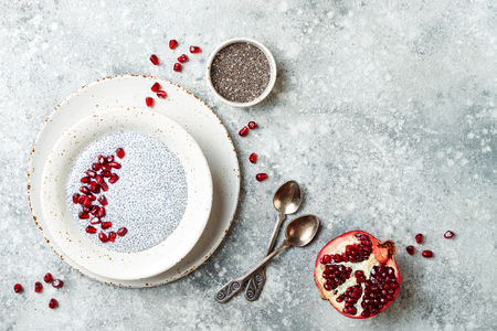Healthy breakfast set. Chia seed pudding bowls with pomegranate.