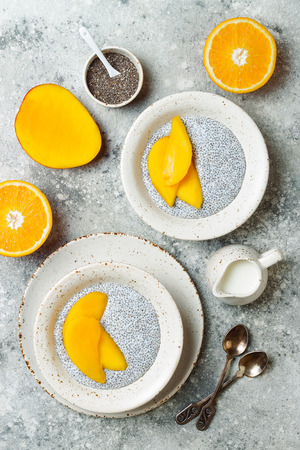 Healthy breakfast set. Chia seed pudding bowls with mango. Stock Photo