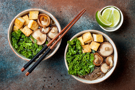 Miso and soba noodles soup with kale, shiitake mushrooms,  roasted tofu Stock Photo