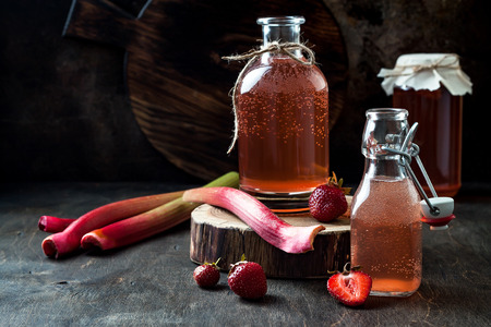 Homemade fermented strawberry and rhubarb kombucha. Healthy natural probiotic flavored drink. Copy space Stok Fotoğraf