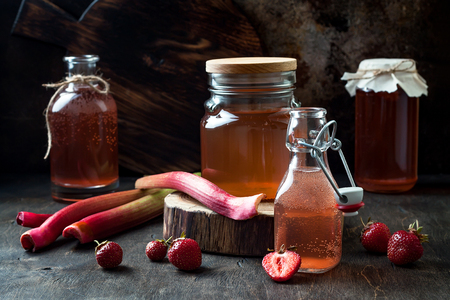 Homemade fermented strawberry and rhubarb kombucha. Healthy natural probiotic flavored drink. Copy space Stock Photo